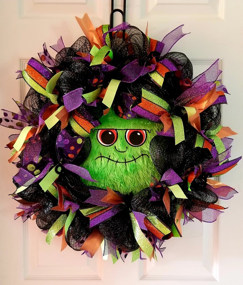 cute green monster face Halloween wreath front door